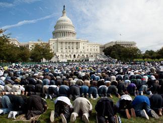 Image of Muslims praying at the Capital